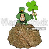 Cartoon St Patricks Day Leprechaun Holding up a Shamrock Behind a Rock © djart #1647989