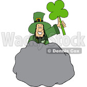 Cartoon St Patricks Day Leprechaun Holding up a Shamrock Behind a Boulder © djart #1647990